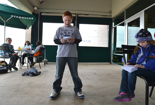 "Kohl Elementary fourth grader Jackson Stone reads his poem, ""Nature Poem"" during Mrs. Fields' Poetry Cafe class at the 287 and Miramonte Starbucks on Friday.<br /> <br /> December 14, 2012<br /> staff photo/ David R. Jennings"