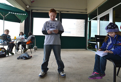 """Kohl Elementary fourth grader Jackson Stone reads his poem, """"Nature Poem"""" during Mrs. Fields' Poetry Cafe class at the 287 and Miramonte Starbucks on Friday.  December 14, 2012 staff photo/ David R. Jennings"""