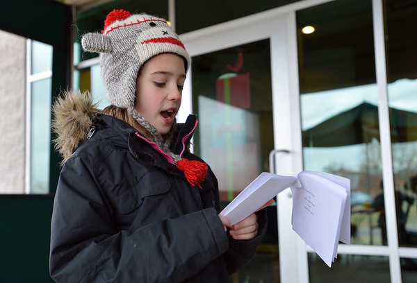"""Kohl Elementary fourth grader Amara Poe reads her poem """"My Couplets"""" for the Poetry Cafe class at the 287 and Miramonte Starbucks on Friday.<br /> <br /> December 14, 2012<br /> staff photo/ David R. Jennings"""