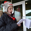 "Kohl Elementary fourth grader Amara Poe reads her poem ""My Couplets"" for the Poetry Cafe class at the 287 and Miramonte Starbucks on Friday.<br /> <br /> December 14, 2012<br /> staff photo/ David R. Jennings"