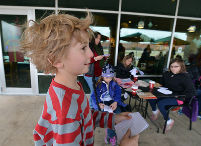 """Kohl Elementary fourth grader Zac Owen reads his poem, """"A War"""" during Mrs. Fields' Poetry Cafe class at the 287 and Miramonte Starbucks on Friday.  December 14, 2012 staff photo/ David R. Jennings"""