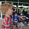 "Kohl Elementary fourth grader Zac Owen reads his poem, ""A War"" during Mrs. Fields' Poetry Cafe class at the 287 and Miramonte Starbucks on Friday.<br /> <br /> December 14, 2012<br /> staff photo/ David R. Jennings"