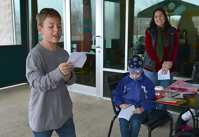 """Kohl Elementary fourth grader Jaden Solano reads his poem """" Jordan's Acrostic Poem"""" for the Poetry Cafe class at the 287 and Miramonte Starbucks on Friday.  December 14, 2012 staff photo/ David R. Jennings"""