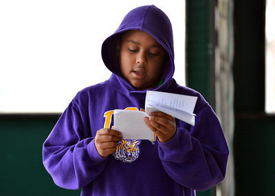 """JP Johnson, Kohl Elementary fourth grader, reds his poem, """"Christmas Joy"""" during Mrs. Fields' the Poetry Cafe class at the 287 and Miramonte Starbucks on Friday.  December 14, 2012 staff photo/ David R. Jennings"""
