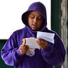 """JP Johnson, Kohl Elementary fourth grader, reds his poem, """"Christmas Joy"""" during Mrs. Fields' the Poetry Cafe class at the 287 and Miramonte Starbucks on Friday.<br /> <br /> December 14, 2012<br /> staff photo/ David R. Jennings"""
