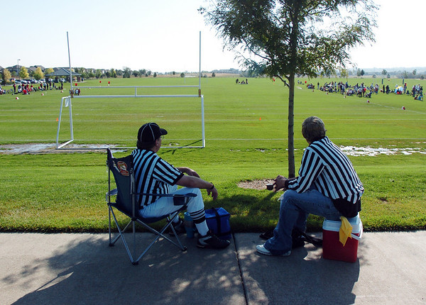 Officials rest in the shade of a tree during a break in action, on Saturday, of the Broomfield Youth Football Association 9-10 year old game between the Bulldogs and Dragons on Labor Day weekend.<br /> <br /> Sept. 5, 2009<br /> Staff photo/David R. Jennings