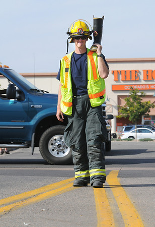 "Firefighter John Brereton, North Metro Fire Rescue, holds a boot collecting money for the Muscular Dystrophy Association ""Fill the Boot"" campaign at 1st Ave, and Chase on Saturday during Labor Day weekend.<br /> <br /> Sept. 5, 2009<br /> Staff photo/David R. Jennings"