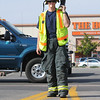 """Firefighter John Brereton, North Metro Fire Rescue, holds a boot collecting money for the Muscular Dystrophy Association """"Fill the Boot"""" campaign at 1st Ave, and Chase on Saturday during Labor Day weekend.<br /> <br /> Sept. 5, 2009<br /> Staff photo/David R. Jennings"""