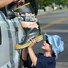 "Aidan Daugherty, 5, holds a boot collecting money for the Muscular Dystrophy Association ""Fill the Boot"" campaign at 1st Ave, and Chase with his father John Daughtery, firefighters Local 2203 MDA Coordinator on Saturday during Labor Day weekend.<br /> <br /> Sept. 5, 2009<br /> Staff photo/David R. Jennings"