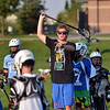 "Coach Dylan Ritger gives pointers to players  during Monarch High School's David Auday lacrosse camp at the Broomfield County CommonsPark on Thursday.<br /> <br /> July 12, 2012<br /> staff photo/ David R. Jennings<br /> <br /> More photos and video please go to <br />  <a href=""http://www.broomfieldenterprise.com"">http://www.broomfieldenterprise.com</a>"