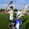 "Assistant coach Philip Bubernak, 15, left, demonstrates  how to throws left to Ethan Wagner, 11,  during Monarch High School's David Auday lacrosse camp at the Broomfield County CommonsPark on Thursday.<br /> <br /> July 12, 2012<br /> staff photo/ David R. Jennings<br /> <br /> More photos and video please go to <br />  <a href=""http://www.broomfieldenterprise.com"">http://www.broomfieldenterprise.com</a>"