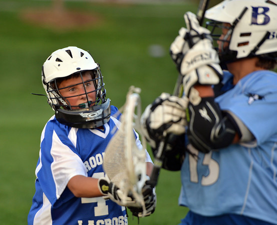 "Goalie Gavin DiFulvio, 12, defends his goal while working on his skills during Monarch High School's David Auday lacrosse camp at the Broomfield County CommonsPark on Thursday.<br /> <br /> July 12, 2012<br /> staff photo/ David R. Jennings<br /> <br /> More photos and video please go to <br />  <a href=""http://www.broomfieldenterprise.com"">http://www.broomfieldenterprise.com</a>"