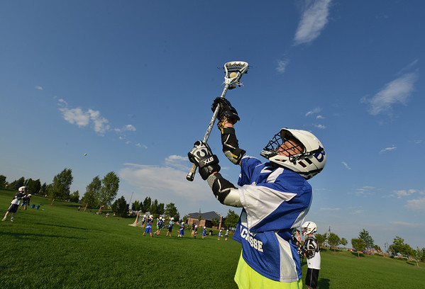 """Jake Borelli, 11, catches the ball  during Monarch High School's David Auday lacrosse camp at the Broomfield County CommonsPark on Thursday.<br /> <br /> July 12, 2012<br /> staff photo/ David R. Jennings<br /> <br /> More photos and video please go to <br />  <a href=""""http://www.broomfieldenterprise.com"""">http://www.broomfieldenterprise.com</a>"""