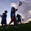 "Lacrosse players work on their skills as the sun sets during Monarch High School's David Auday lacrosse camp at the Broomfield County CommonsPark on Thursday.<br /> <br /> July 12, 2012<br /> staff photo/ David R. Jennings<br /> <br /> More photos and video please go to <br />  <a href=""http://www.broomfieldenterprise.com"">http://www.broomfieldenterprise.com</a>"