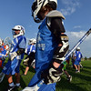 "Lacrosse players walk to perform their next drill during Monarch High School's David Auday lacrosse camp at the Broomfield County CommonsPark on Thursday.<br /> <br /> July 12, 2012<br /> staff photo/ David R. Jennings<br /> <br /> More photos and video please go to <br />  <a href=""http://www.broomfieldenterprise.com"">http://www.broomfieldenterprise.com</a>"