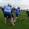 "Lacrosse players fight for the ball during Monarch High School's David Auday lacrosse camp at the Broomfield County CommonsPark on Thursday.<br /> <br /> July 12, 2012<br /> staff photo/ David R. Jennings<br /> <br /> More photos and video please go to <br />  <a href=""http://www.broomfieldenterprise.com"">http://www.broomfieldenterprise.com</a>"