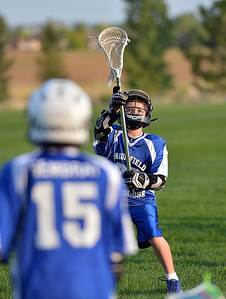 Ethan Wagner, 11, catches the ball  during Monarch High School's David Auday lacrosse camp at the Broomfield County CommonsPark on Thursday.  July 12, 2012 staff photo/ David R. Jennings  More photos and video please go to  www.broomfieldenterprise.com