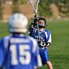 "Ethan Wagner, 11, catches the ball  during Monarch High School's David Auday lacrosse camp at the Broomfield County CommonsPark on Thursday.<br /> <br /> July 12, 2012<br /> staff photo/ David R. Jennings<br /> <br /> More photos and video please go to <br />  <a href=""http://www.broomfieldenterprise.com"">http://www.broomfieldenterprise.com</a>"