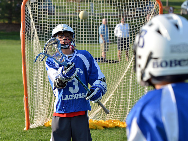 "Griphen Jolly, 11, left, catches the ball thrown by teammate Jake Borelli, 11,  during Monarch High School's David Auday lacrosse camp at the Broomfield County CommonsPark on Thursday.<br /> <br /> July 12, 2012<br /> staff photo/ David R. Jennings<br /> <br /> More photos and video please go to <br />  <a href=""http://www.broomfieldenterprise.com"">http://www.broomfieldenterprise.com</a>"
