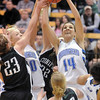 Broomfield's Katie Nehf and Bre Burgesser, left,  rebound the ball from Conifer's Alison Gorrell during the Class 4A great eight game at the Colorado School of Mines on Friday.<br /> March 4, 2011<br /> staff photo/David R. Jennings