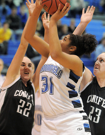 Broomfield's Tyana Medema shoots the ball against the efforts of Conifer's Bailey Miller and Alison Gorrell during the Class 4A great eight game at the Colorado School of Mines on Friday.<br /> March 4, 2011<br /> staff photo/David R. Jennings