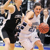 Broomfield's Brittney Zec drives the ball to the basket against Conifer's Becca Midcap during the Class 4A great eight game at the Colorado School of Mines on Friday.<br /> March 4, 2011<br /> staff photo/David R. Jennings
