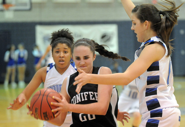 Broomfield's Tyana Medema, left, and Katie Nehf box in Conifer's Amanda Taney during the Class 4A great eight game at the Colorado School of Mines on Friday.<br /> March 4, 2011<br /> staff photo/David R. Jennings