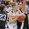 Broomfield's Meagan Prins tries to get to the basket against Conifer's Alison Gorrell and  Paige Robertson during the Class 4A great eight game at the Colorado School of Mines on Friday.<br /> March 4, 2011<br /> staff photo/David R. Jennings