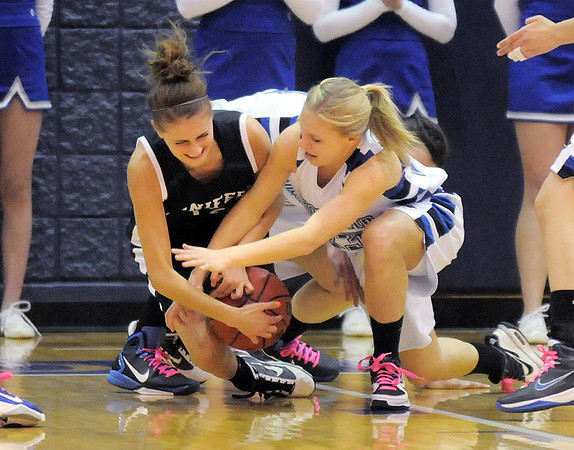 Broomfield's Morgan Rynearson scrambles for the ball against Conifer's  Bailey Miller during the Class 4A great eight game at the Colorado School of Mines on Friday.<br /> March 4, 2011<br /> staff photo/David R. Jennings