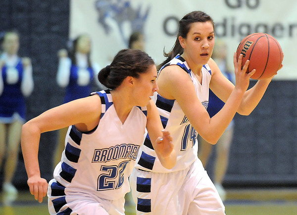 After stealing the ball from Conifer, Broomfield's Katie Nehf takes the ball down court with Brittney Zec during the Class 4A great eight game at the Colorado School of Mines on Friday.<br /> March 4, 2011<br /> staff photo/David R. Jennings