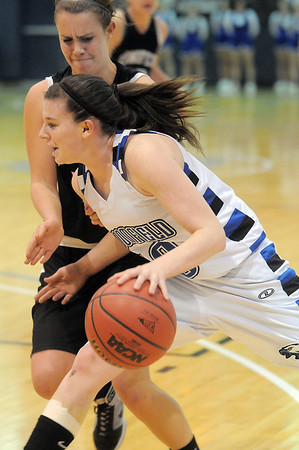 Broomfield's Bre Wilber drives the ball to the basket against Conifer's Katie Ellerman during the Class 4A great eight game at the Colorado School of Mines on Friday.<br /> March 4, 2011<br /> staff photo/David R. Jennings