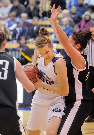 Broomfield's Meagan Prins drives to the basket against Conifer's Paige Robertson during the Class 4A great eight game at the Colorado School of Mines on Friday.<br /> March 4, 2011<br /> staff photo/David R. Jennings