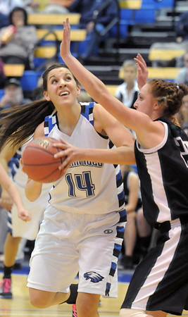 Broomfield's Katie Nehf goes to the basket against Conifer's Alison Gorrell during the Class 4A great eight game at the Colorado School of Mines on Friday.<br /> March 4, 2011<br /> staff photo/David R. Jennings