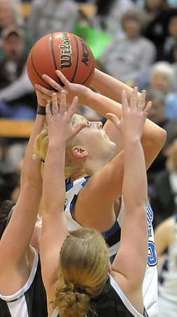 Broomfield's Bre Burgesser shoots the ball against Conifer during the Class 4A great eight game at the Colorado School of Mines on Friday.<br /> March 4, 2011<br /> staff photo/David R. Jennings