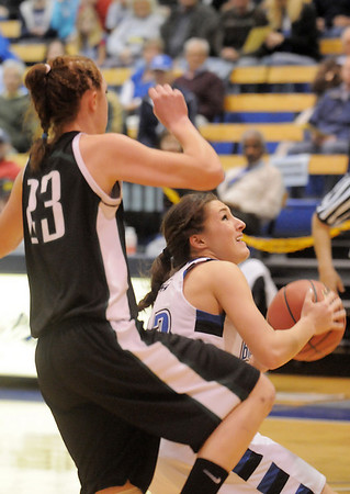 Broomfield's Brittney Zec goes to the basket against Conifer's Alison Gorrell during the Class 4A great eight game at the Colorado School of Mines on Friday.<br /> March 4, 2011<br /> staff photo/David R. Jennings