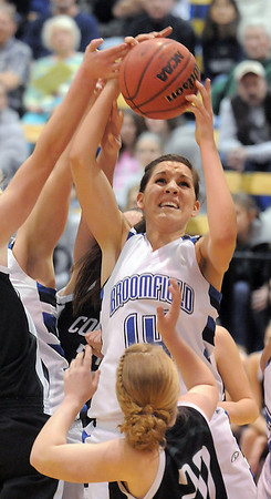 Broomfield's Katie Nehf rebounds the ball against Conifer's Alison Gorrell during the Class 4A great eight game at the Colorado School of Mines on FRiday.<br /> March 4, 2011<br /> staff photo/David R. Jennings