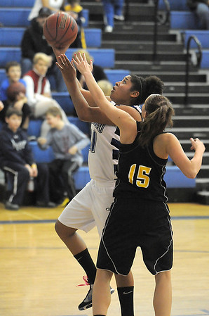 Broomfield's Tyana Medema drives to the basket past Thompson Valley's Kenzie Archer during Wednesday's game at Broomfield High.<br /> December 15, 2010<br /> staff photo/David R. Jennings