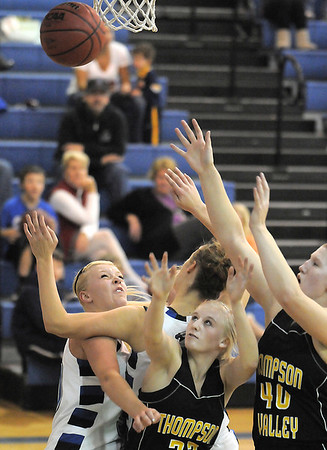 Broomfield's Bre Bugesser, left, and Meagan Prins fight to rebound the ball with Thompson Valley's Lexy Schoonover and Jordan Sibrel  during Wednesday's game at Broomfield High.<br /> December 15, 2010<br /> staff photo/David R. Jennings