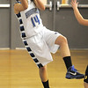 Broomfield's Katie Nehf throws the ball to stay inbounds during Wednesday's game against Thompson Valley at Broomfield High.<br /> December 15, 2010<br /> staff photo/David R. Jennings