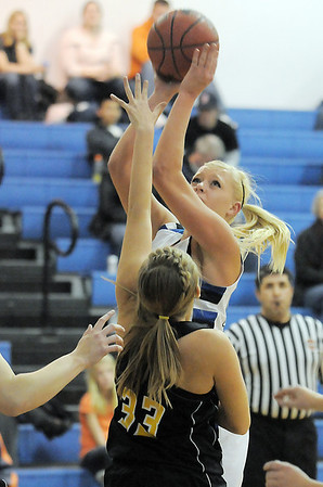 Broomfield's Bre Burgesser shoots for two over Thompson Valley's Alexis Hunt during Wednesday's game at Broomfield High.<br /> December 15, 2010<br /> staff photo/David R. Jennings