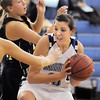 Broomfield's Katie Nehf fights her way to the basket during Wednesday's game against Thompson Valley at Broomfield High.<br /> December 15, 2010<br /> staff photo/David R. Jennings