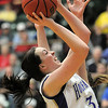 Sierra Williamson, Holy Family goes to the basket against Jefferson Academy during the 3A Final Four game at Moby Gym in Ft. Collins on Friday.<br /> March 11, 2011<br />  staff photo/David R. Jennings