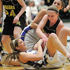 Holy Family's Stephanie Giltner fights for the ball with Jefferson Academy's Madison Page during the 3A Final Four game at Moby Gym in Ft. Collins on Friday.<br /> March 11, 2011<br />  staff photo/David R. Jennings