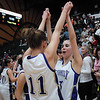 Holy Family's Taylor Helbig, left, and Carolina Gutierrez celebrate their victory over Jefferson Academy 59-38 in the 3A Final Four game at Moby Gym in Ft. Collins on Friday.<br /> March 11, 2011<br />  staff photo/David R. Jennings
