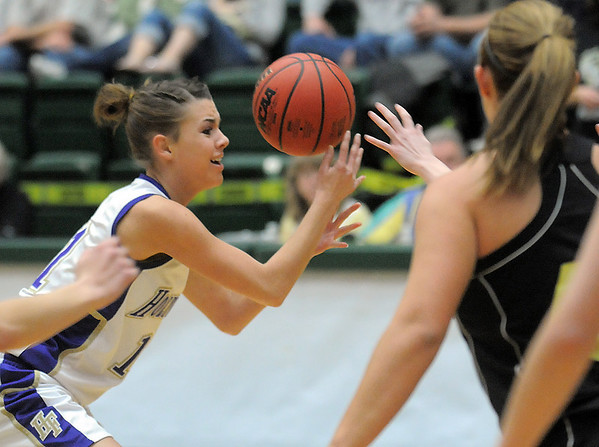 Holy Family's Taylor Helbig grabs a loose ball from Jefferson Academy during the 3A Final Four game at Moby Gym in Ft. Collins on Friday.<br /> March 11, 2011<br />  staff photo/David R. Jennings