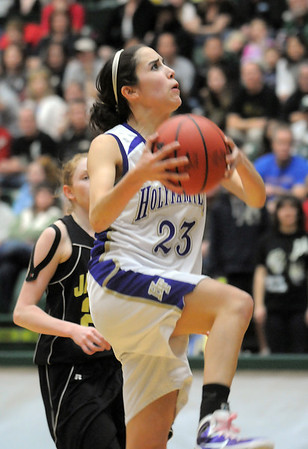 Holy Family's Carolina Gutierrez goes up for two against Jefferson Academy during the 3A Final Four game at Moby Gym in Ft. Collins on Friday.<br /> March 11, 2011<br />  staff photo/David R. Jennings