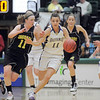 Taylor Helbig, Holy Family dribbles the ball downcourt against Madison Page, Jefferson Academy during the 3A Final Four game at Moby Gym in Ft. Collins on Friday.<br /> March 11, 2011<br />  staff photo/David R. Jennings
