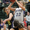 Stephanie Giltner, Holy Family goes up for two against Haley Loptein and Kelsey Wall, Jefferson Academy during the 3A Final Four game at Moby Gym in Ft. Collins on Friday.<br /> March 11, 2011<br />  staff photo/David R. Jennings
