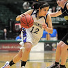 Megan Chavez, Holy Familydrives the ball past Katherine Jennings, Jefferson Academy during the 3A Final Four game at Moby Gym in Ft. Collins on Friday.<br /> March 11, 2011<br />  staff photo/David R. Jennings