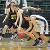 Megan Chavez, Holy Family recovers a loose ball from Sara Miller,  Jefferson Academy during the 3A Final Four game at Moby Gym in Ft. Collins on Friday.<br /> March 11, 2011<br />  staff photo/David R. Jennings